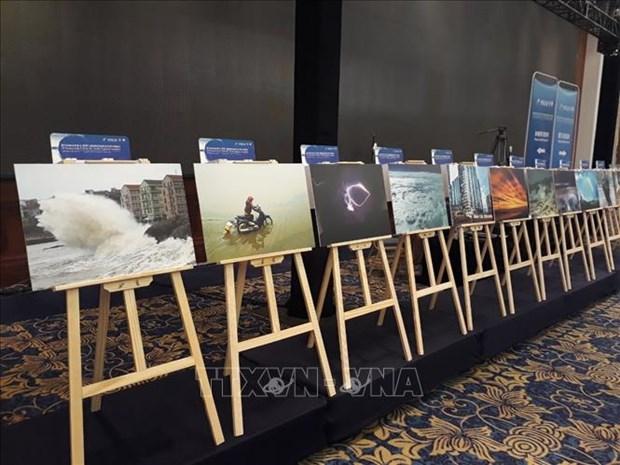 """越南作品在中国广州""""台风委员会区域天气和气候""""摄影比赛中荣获一等奖 hinh anh 1"""