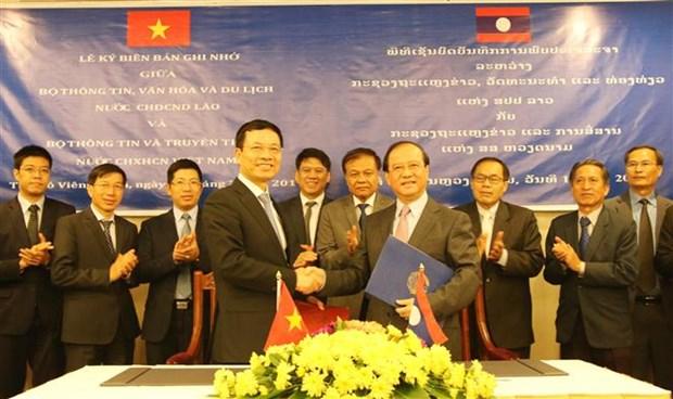 越南与老挝推动信息传媒合作迈上新台阶 hinh anh 1