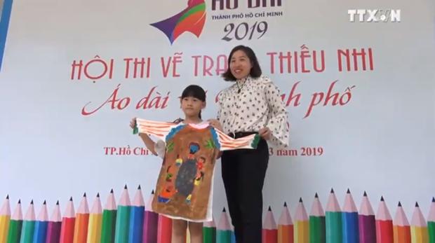 青年儿童通过绘画活动体现对传统奥黛之爱 hinh anh 2
