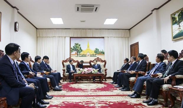 老挝领导对越南信息传媒部和老挝各部门合作的有效性给予高度评价 hinh anh 1