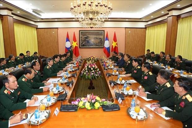 老挝人民军高级政治干部代表团对越南进行正式访问 hinh anh 2
