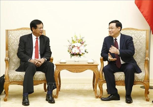政府副总理王廷惠与老挝前总理波松·布帕万分享合作社发展经验 hinh anh 2