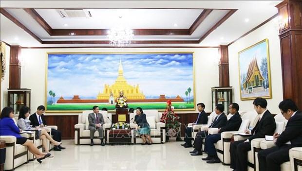 庆祝老挝人民革命党建党64周年 hinh anh 1