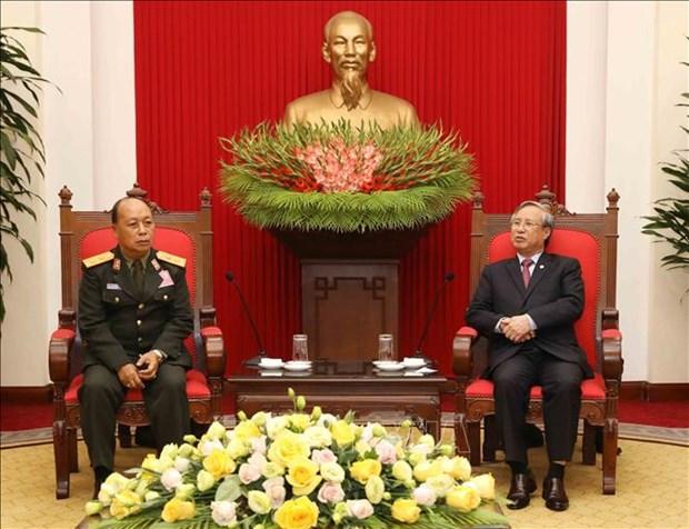 越共中央书记处常务书记陈国旺会见老挝人民军高级政治代表团 hinh anh 1