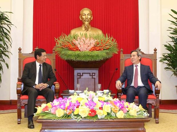 越共中央经济部部长阮文平会见老挝国家经济研究院工作代表团 hinh anh 1