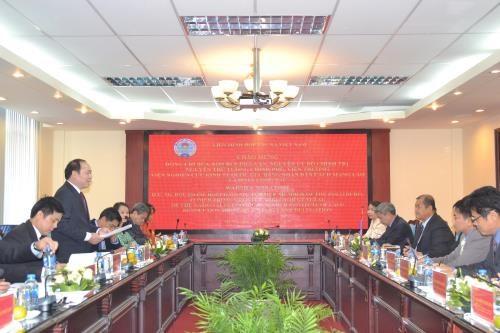 越南与老挝促进集体经济发展合作 hinh anh 1