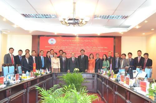 越南与老挝促进集体经济发展合作 hinh anh 2