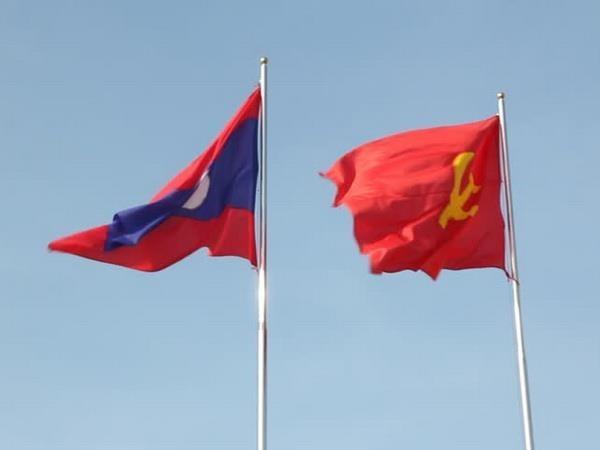 越南领导人致贺电庆祝老挝人民革命党成立64周年 hinh anh 1