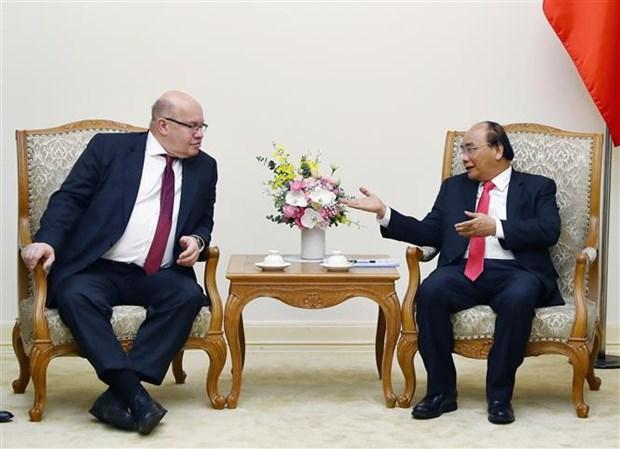 越南政府总理阮春福会见德国联邦经济和能源部长阿尔特迈尔 hinh anh 1