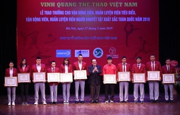 越南体育日:越南各优秀运动员获表彰 hinh anh 1