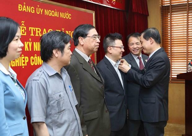 海外党建工作对祖国建设和保卫事业作出有效贡献 hinh anh 3