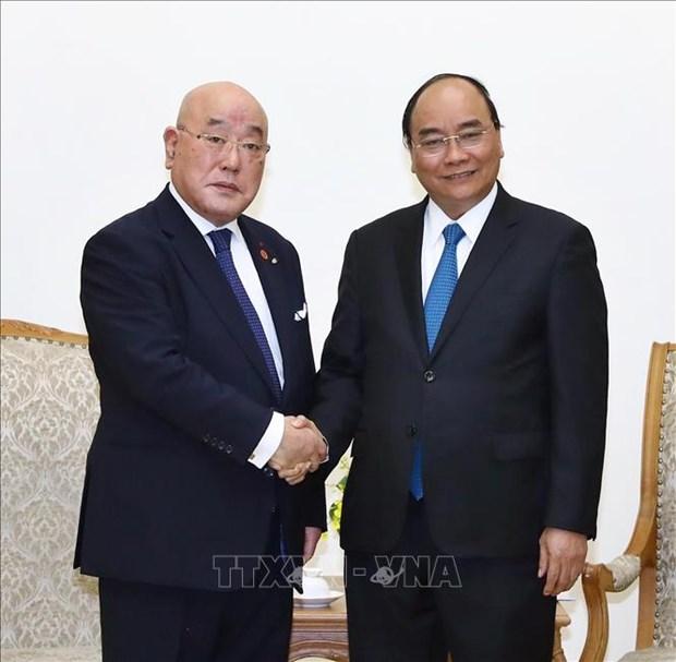 政府总理阮春福会见日本首相特别顾问饭岛勋 hinh anh 1