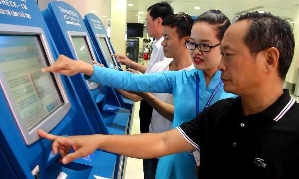 越航在许多国家机场设置自动值机柜台 hinh anh 1
