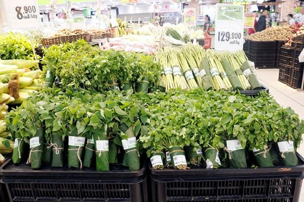 越南超市妙用香蕉叶包装蔬菜吸引新加坡媒体的关注 hinh anh 1