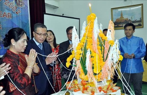 越南驻中国大使邓明魁到老挝使馆拜年 hinh anh 2