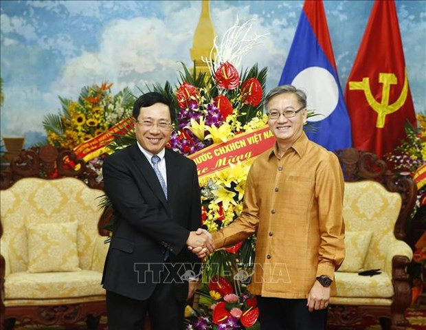 老挝迎来传统新年 越南政府副总理范平明送祝福 hinh anh 1