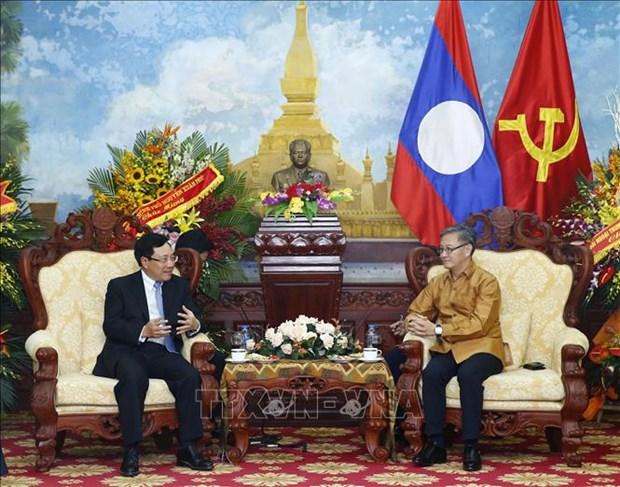 老挝迎来传统新年 越南政府副总理范平明送祝福 hinh anh 2