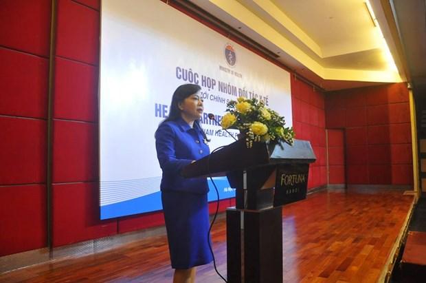 世界卫生组织代表表示:越南已经有效地实施了全民健康保险计划 hinh anh 1