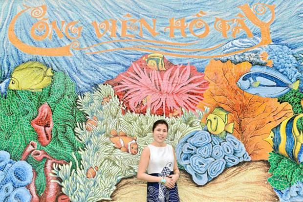 内排国际机场的莲花壁画荣获国际设计奖金牌 hinh anh 2