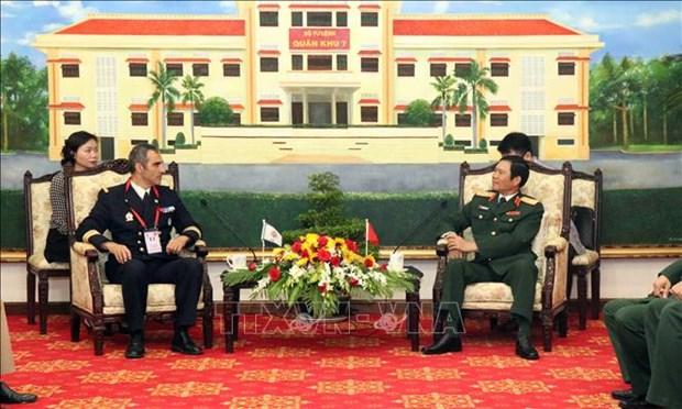越南人民军队副总参谋长阮新疆中将会见国际军体主席 hinh anh 1