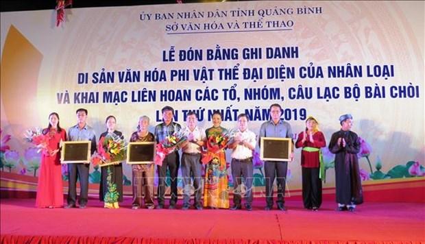 越南中部发牌唱曲艺术UNESCO非物质文化遗产证书授证仪式在广平省举行 hinh anh 1