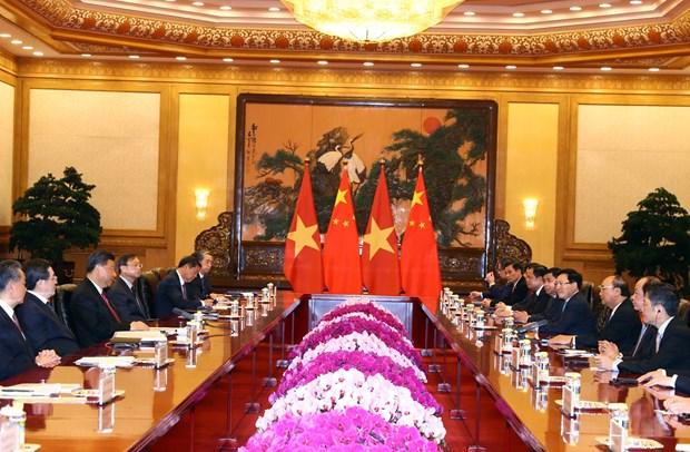 越南政府总理阮春福会见中共中央总书记、国家主席习近平 hinh anh 2