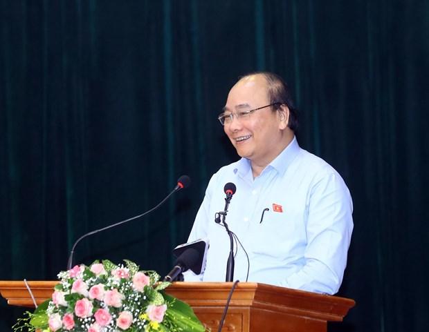 越南政府总理阮春福:发展的最终目的是为人民服务 hinh anh 2