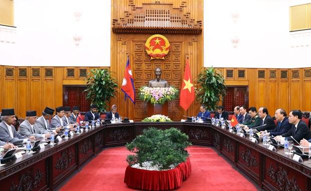 越南政府总理阮春福与尼泊尔总理奥利举行会谈 hinh anh 1