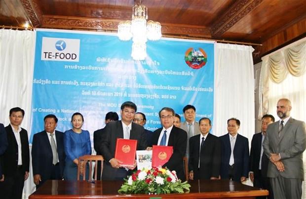越南企业协助老挝建立动物疫病防治体系 hinh anh 1