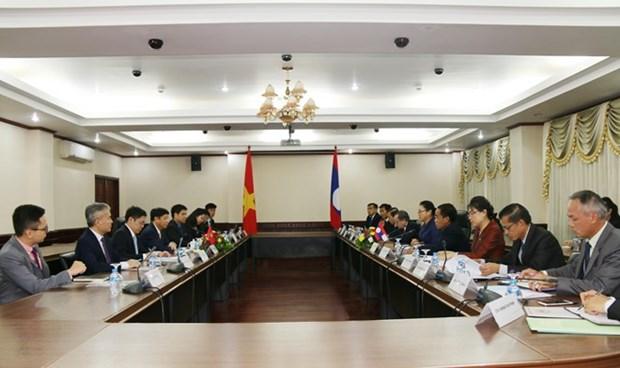 老挝高度评价在老越南人的积极贡献 hinh anh 1