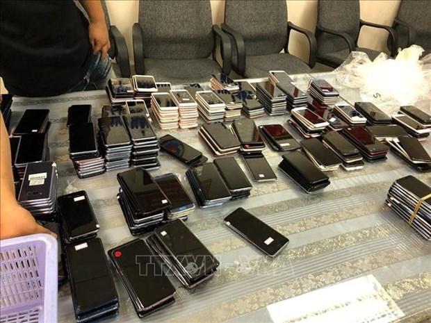 越南胡志明市新山一海关缴获未申报海关的一大批手机 hinh anh 1
