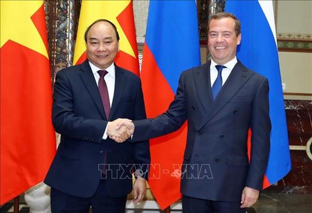 越俄两国总理共同主持记者会 对外通报会谈结果 hinh anh 1