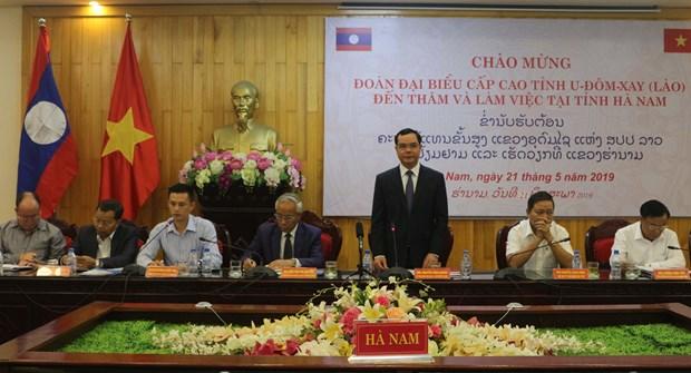 大力推动越南河南省与老挝乌多姆塞省的合作 hinh anh 1