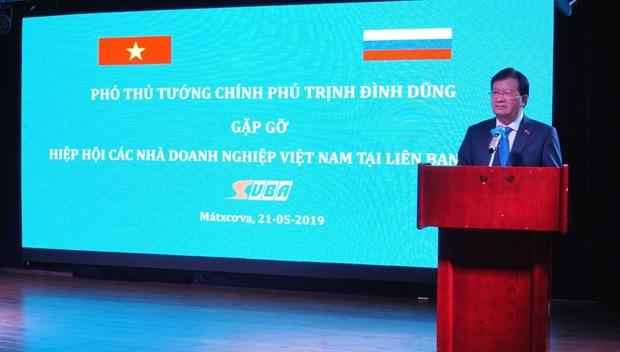 越南政府副总理郑廷勇会见在俄越南企业 hinh anh 1