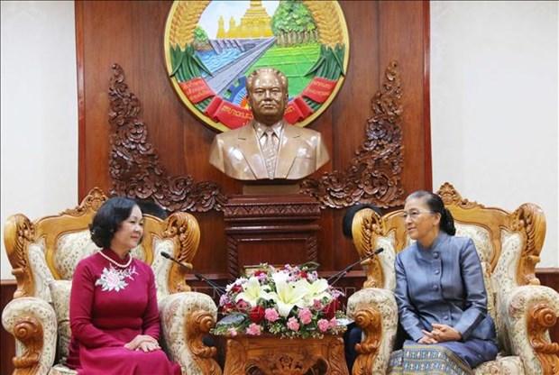 老挝领导人:像保护自己的眼珠一样地保护好越老伟大友好、特殊团结关系 hinh anh 2