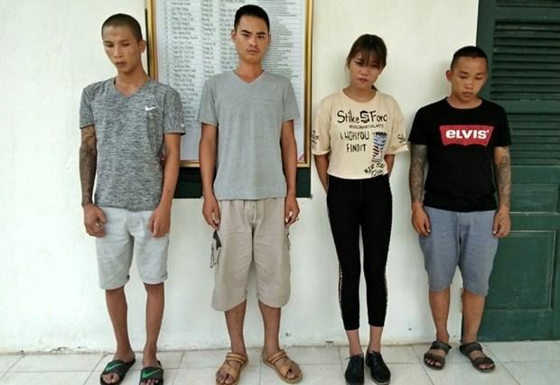 莱州省边防在越中边境破获一起人口贩卖案 抓获 4名犯罪嫌疑人 hinh anh 2