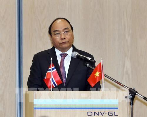 越南政府总理阮春福出席越南与挪威企业论坛 hinh anh 1