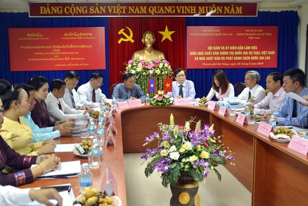 越老两国加强出版领域的合作 hinh anh 1