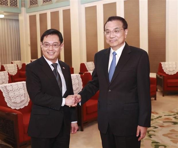 中国与新加坡加强合作 共同维护基于规则的自由贸易 hinh anh 1