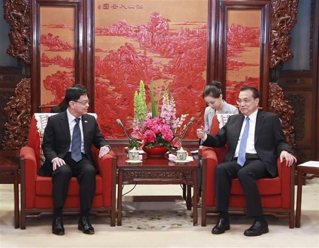 中国与新加坡加强合作 共同维护基于规则的自由贸易 hinh anh 2