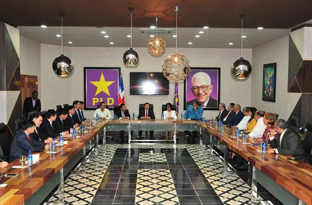 越南共产党代表团对多米尼加进行工作访问 hinh anh 2