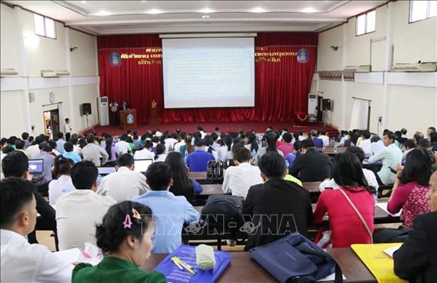 越南与老挝加强合作 提高教育培训质量 hinh anh 1