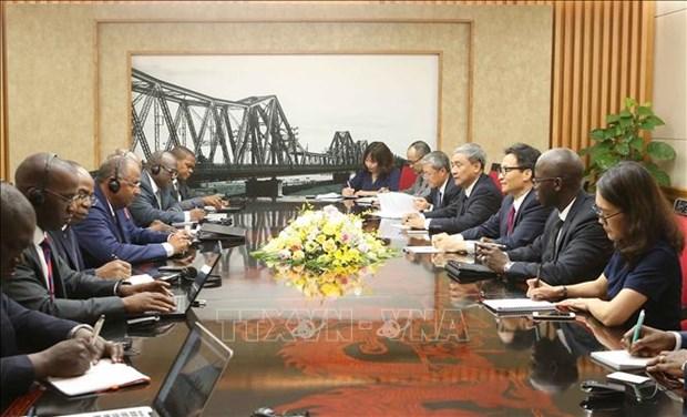 武德儋副总理会见科特迪瓦政府高级代表团 hinh anh 1