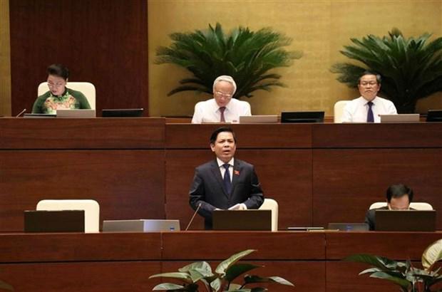 越南第十四届国会第七次会议:交通运输部就进度迟缓的交通项目作报告 hinh anh 1