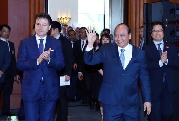 越南政府总理和意大利总理朱塞佩·孔特共同主持意大利-东盟企业论坛 hinh anh 1