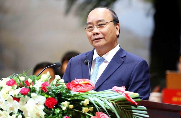 政府总理阮春福: 越南愿为国际致力于和平、安全、发展和进步的努力做出积极贡献 hinh anh 1