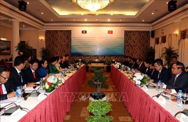 胡志明市与老挝万象加强党建工作合作 hinh anh 1