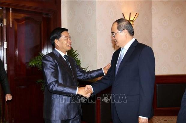 胡志明市与老挝首都万象促进全面合作 hinh anh 1