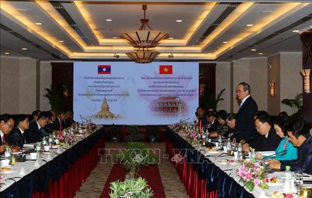 胡志明市与老挝首都万象促进全面合作 hinh anh 2