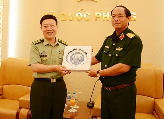 中国人民解放军国防大学政治学院代表团访问越南 hinh anh 1